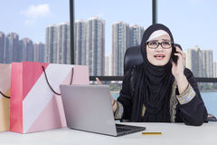 Arabian woman angry after shopping online Stock Images