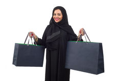 Arabian woman carrying shopping bags isolated on white royalty free stock photography