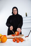 Arabian woman cooking Stock Photo