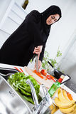 Arabian woman cooking Stock Photos