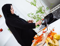 Arabian woman cooking Royalty Free Stock Photography