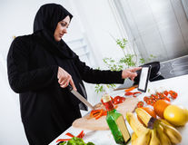 Arabian woman cooking in the kitchen Stock Photos