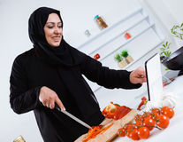 Arabian woman cooking in the kitchen Royalty Free Stock Image