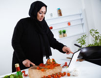 Arabian woman cooking in the kitchen Stock Image
