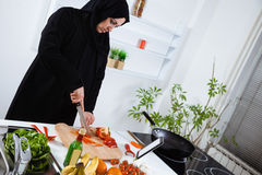 Arabian woman cooking in the kitchen Royalty Free Stock Photography