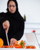 Arabian woman cooking in the kitchen Royalty Free Stock Photo