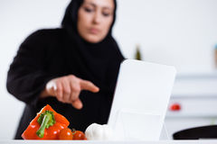 Arabian woman cooking in the kitchen Stock Photography