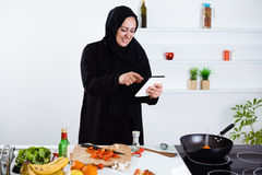 Arabian woman cooking in the kitchen Royalty Free Stock Photos