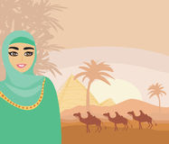 Arabian woman in the desert Royalty Free Stock Image