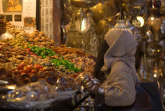 Free Arabian Woman Doing The Expense Of Sweets And Dried Fruits Royalty Free Stock Photography - 70310317
