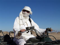 Arabian woman driving quad. On a desert Royalty Free Stock Photo