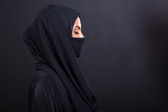 Arabian woman with eyes closed. Mysterious arabian woman with eyes closed on black background Stock Images