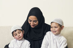 Arabian woman holding her children, mother and sons Royalty Free Stock Photo