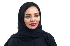 Arabian woman posing against a white background