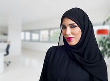 Arabian woman posing in a business center Stock Photography