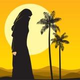 Arabian woman in sahara Royalty Free Stock Image