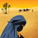 Arabian woman in sahara Stock Photography