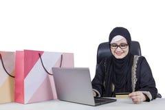 Arabian woman shopping online Stock Photos