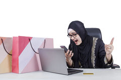 Arabian woman shouting on the phone Royalty Free Stock Image
