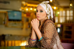 Arabian woman sitting in a cafe Royalty Free Stock Photography