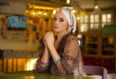 Arabian woman sitting in a cafe Stock Photos