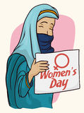 Arabian Woman with Traditional Clothes And Women's Day Sign, Vector Illustration. Arabian woman holding a banner with Women's Day text with traditional blue Stock Image