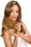 Arabian woman wearing wig and holding purse Stock Photos