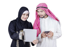 Arabian workers discussing with tablet Royalty Free Stock Images