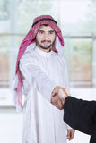 Arabian workers shaking hands in office Royalty Free Stock Images