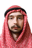 Arabian young man. Portrait of an arabian young man in traditional headscarf - shemagh Stock Images