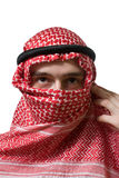 Arabian young man. Portrait of an arabian young man in traditional headscarf - shemagh Royalty Free Stock Images