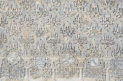 Arabic. Closeup of a wall of white plaster Arabic in the Reales Alcazares, Seville, Andalucia, Spain royalty free stock photography