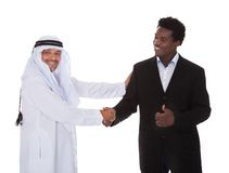Arabic And African Man Shaking Hands Royalty Free Stock Image
