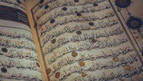 Arabic Alphabet On Al Quran Book. Reading Comprehence In Muslim Religion royalty free stock image