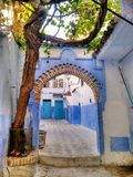 Arabic arch way. Rustic arch way in an alley of the blue city in Morocco Royalty Free Stock Photos
