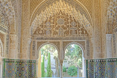 Arabic arch and window. Image taken of window, art detail and decorative walls of the Alhambra Palace in Granada, spain Stock Photos