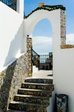 Arabic architectural arch, Tunisia. Arabic architectural arch and stairs in Tunisia Royalty Free Stock Photography
