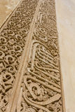 Arabic art on a palace wall. Detail on a wall of amazing Alhambra palace in Andalusia, Spain. Mixture of Arabic and European art Royalty Free Stock Images