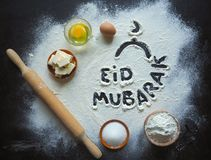 Arabic baking background. Eid Mubarak is a traditional Muslim greeting reserved.  Royalty Free Stock Photography