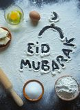 Arabic baking background. Eid Mubarak is a traditional Muslim greeting reserved.  Stock Images