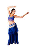 Arabic belly dancer. Beautiful Arabic belly dancer harem woman in blue with silver dress and head jewelry with gem dancing swirling her arms, isolated Royalty Free Stock Image