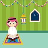 Arabic Boy reading Holy Book