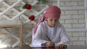 Arabic boy is writing. stock video