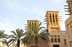 Arabic building with wind towers during sunset Royalty Free Stock Photo