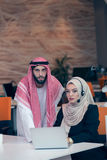 Arabic business couple working together on project at modern startup office Stock Photo