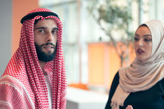 Arabic business couple working together on project at modern startup office Royalty Free Stock Images