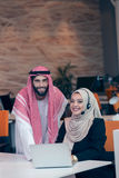 Arabic business couple working together on project at modern startup office Royalty Free Stock Photos