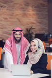 Arabic business couple working together on project at modern startup office Stock Image