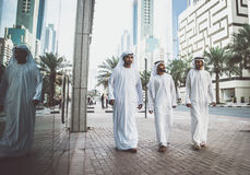 Arabic business men spending together. Three arabic business men walking in Dubai Royalty Free Stock Photography