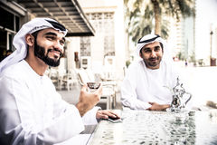 Arabic business men spending together. Arabic business men spending time in Dubai Stock Photos